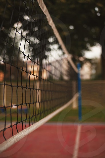 On playground volleyball net details during day outdoor closeup scene.  photo