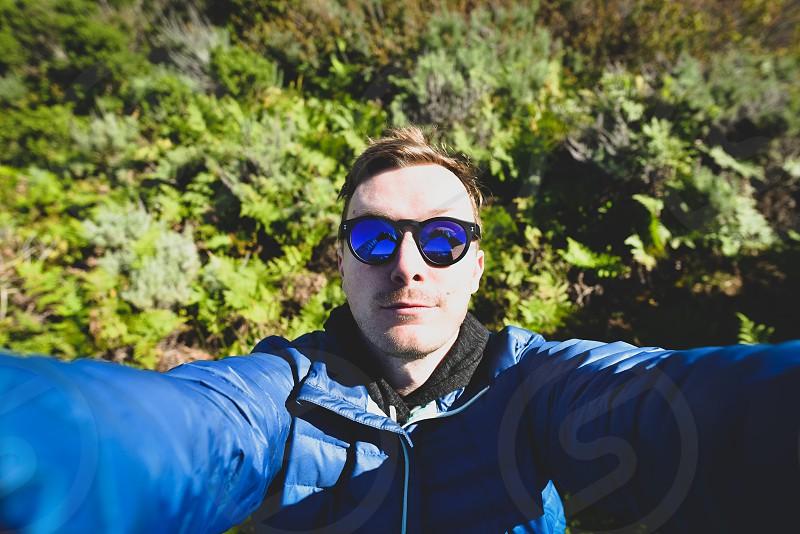 selfie man camping nature outdoors blue sun photo