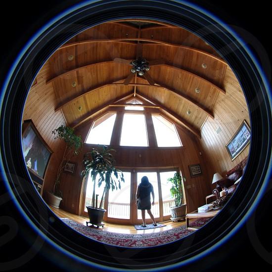 woman in black dress fish eye photography photo