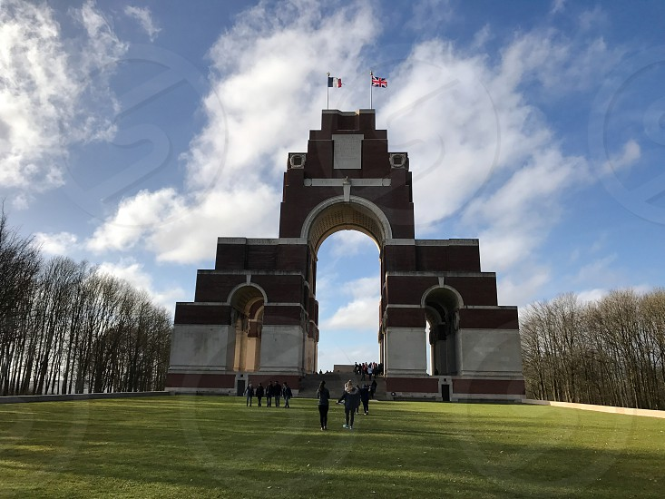 Outdoor day landscape horizontal colour Thiepval France view vista farm fields grass trees nature country countryside Europe European sky clouds blue winter barren bare Great Britain Union Jack Flag flags war memorial monument WWI WW1 World War One First World War remembrance stone unknown burial Somme The Somme site Battle photo