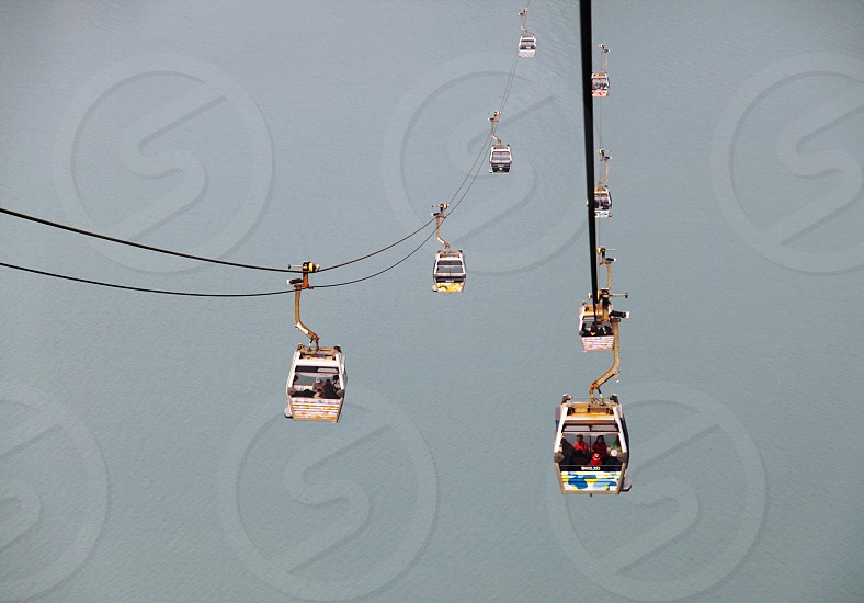 group of people riding cable cart during daytime photo
