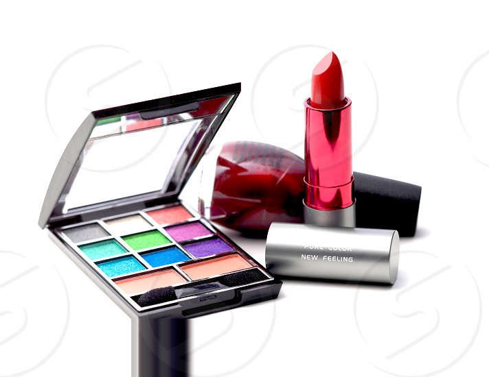 makeup tools on white background photo