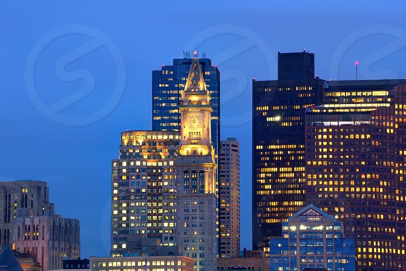 Boston skyline at sunset Custom tower Clock tower in Massachusetts USA photo
