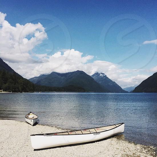 2 white canoes near river photo
