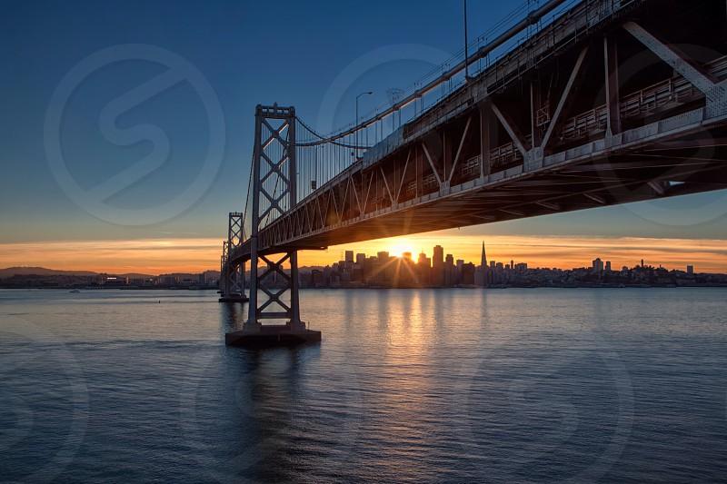 bridge and city building sunset photography  photo