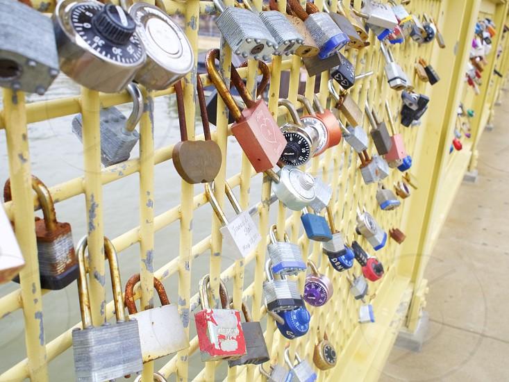 Locks of love on yellow bridge     photo