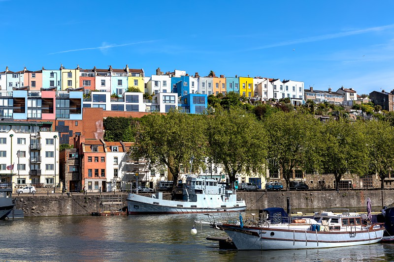 BRISTOL UK - MAY 14 : View of boats and colourful apartments along the River Avon in Bristol on May 14 2019. One unidentified person photo