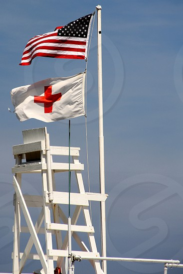 A Lifeguard chair at the ready on a breezy summer day. photo