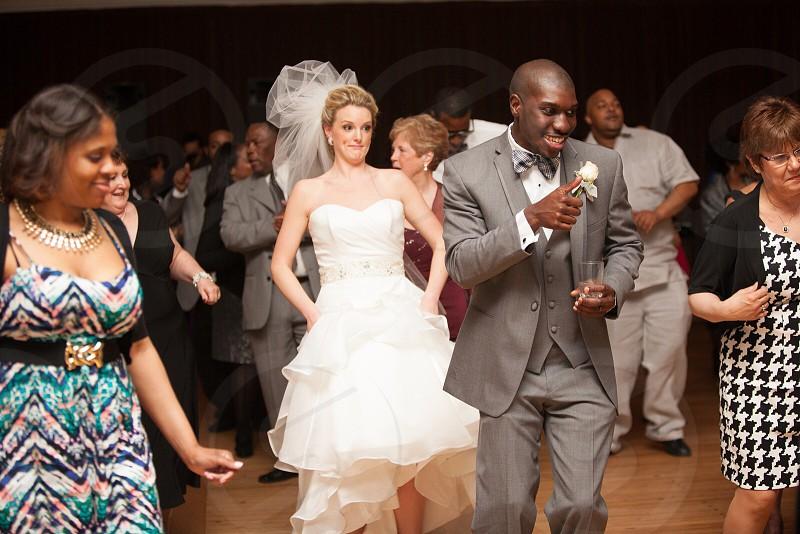 people dancing at wedding reception photo